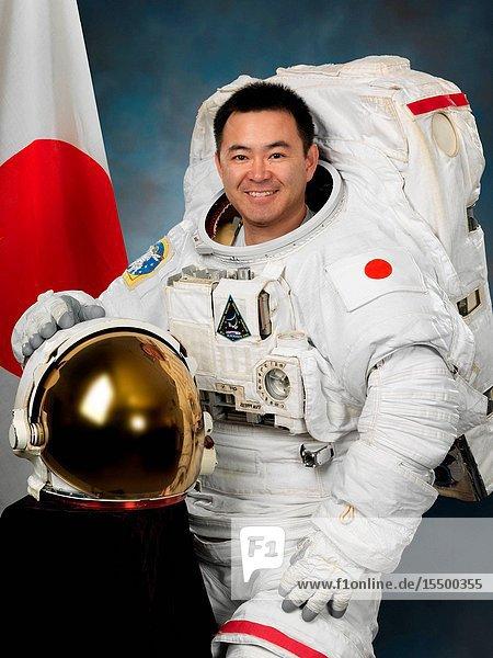 Japan Aerospace Exploration Agency (JAXA) astronaut Akihiko Hoshide  attired in a training version of his Extravehicular Mobility Unit (EMU) spacesuit.