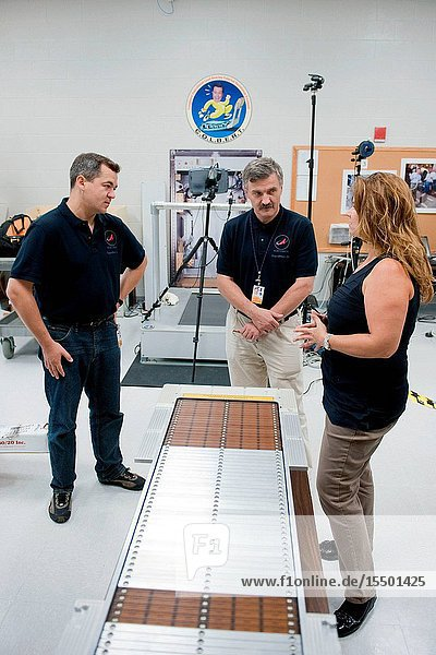 Russian cosmonauts Oleg Skripochka (left) and Alexander Kaleri  both Expedition 2526 flight engineers  participate in an in-flight maintenance training session in the Biomedical Treadmill Lab at NASA's Johnson Space Center. Crew instructor Kimberlee Jadwick assisted the crew members.