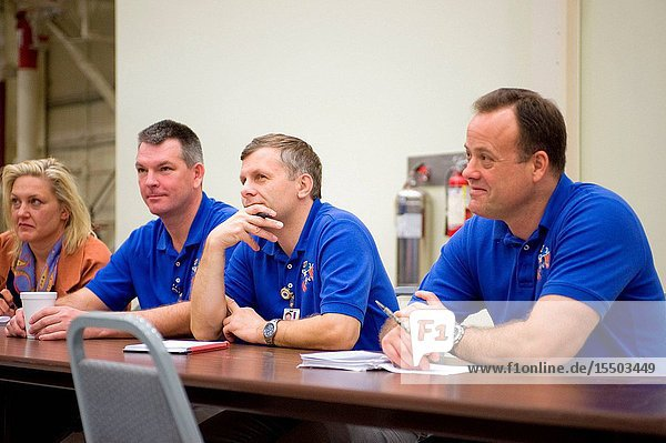 Russian cosmonaut Andrey Borisenko (center),  Expedition 27 flight engineer and Expedition 28 commander,  along with Russian cosmonaut Alexander Samokutyaev and NASA astronaut Ron Garan (right),  both Expedition 2728 flight engineers,  participate in a routine operations training session in the Space Vehicle Mock-up Facility at NASA's Johnson Space Center. LOCATION: Bldg 9NW,  ISS Mockups