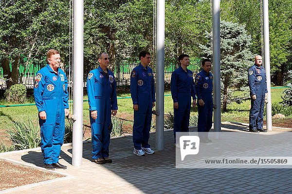 At the Cosmonaut Hotel crew quarters in Baikonur  Kazakhstan  the Expedition 28 prime and backup crew members participate in the traditional flag raising ceremony May 27  2011 as part of their preparations leading to launch of NASA astronaut Mike Fossum  flight engineer  Russian cosmonaut Sergei Volkov  Soyuz commander and flight engineer  and Japan Aerospace Exploration Agency astronaut Satoshi Furukawa  flight engineer  on June 8 (Kazakhstan time) on the Soyuz TMA-02M spacecraft to the International Space Station. From left to right are Fossum and his backup  NASA's Don Pettit  Volkov and his backup  Oleg Kononenko  and Furukawa and his backup  Andre Kuipers of the European Space Agency.Victor Zelentsov
