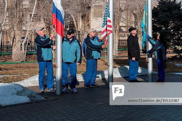 At their Cosmonaut Hotel crew quarters in Baikonur  Kazakhstan  the Expedition 3940 crew members raise the flags of Russia  the United States and Kazakhstan March 15 in traditional ceremonies that are part of crew training. From left to right are Soyuz Commander Alexander Skvortsov and Flight Engineer Oleg Artemyev of the Russian Federal Space Agency (Roscosmos)  Flight Engineer Steve Swanson of NASA  and backup crew members Alexander Samokutyaev and Elena Serova of Roscosmos. Swanson  Skvortsov and Artemyev are scheduled to launch to the International Space Station March 26 (Kazakh time) for the start of a six-month mission. Photo credit: NASAVictor Zelentsov