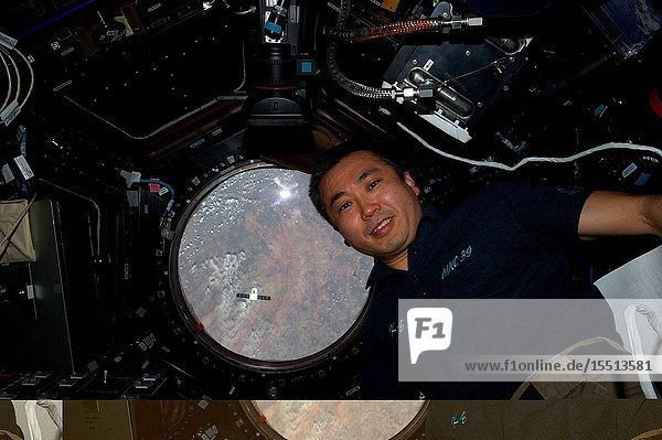 It almost appears that Expedition 39 Commander Koichi Wakata has spotted the SpaceX Dragon approaching and has turned to announce to his crewmates on the International Space Station  Supplies are coming  supplies are coming! The Dragon spacecraft can be seen as a small dot in lower left of a Cupola window. This is one of an extensive series of still photos documenting the April 20 arrival and ultimate capture and berthing of the Dragon at the International Space Station  as photographed by the Expedition 39 crew members onboard the orbital outpost. Soon after the photo was made  the Dragon spacecraft was captured by the space station and successfully berthed using the Canadian-built space station remote manipulator system or Canadarm2.