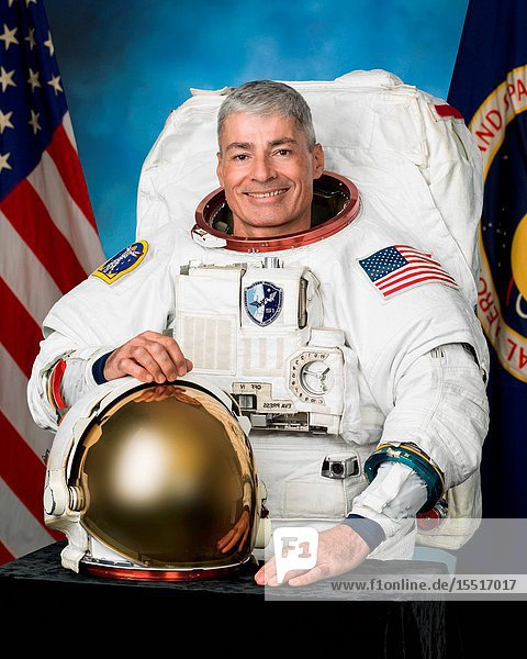 Official astronaut portrait of Expedition 51 crew member Mark Vande Hei in a spacesuit (EMU).