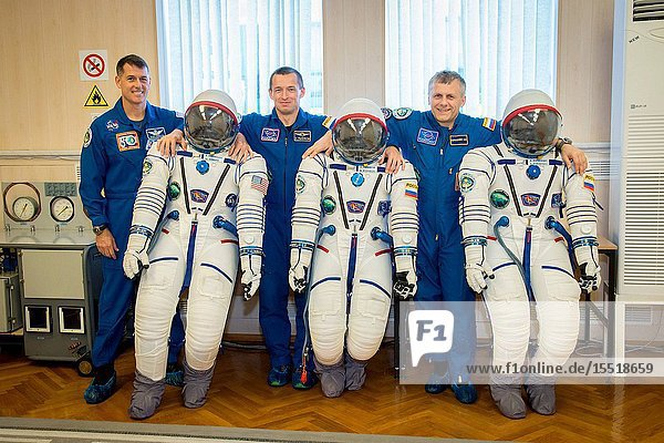 At the Integration Facility at the Baikonur Cosmodrome in Kazakhstan  Expedition 49 crewmembers Shane Kimbrough of NASA (left) and Sergey Ryzhikov (center) and Andrey Borisenko (right) of Roscosmos share a light-hearted moment Sept. 9 as they pose for pictures with their Sokol launch and entry suits during a pre-launch training fit check. Kimbrough  Ryzhikov and Borisenko will launch Sept. 24  Kazakh time on the Soyuz MS-02 vehicle for a five-month mission on the International Space Station..NASAVictor Zelentsov