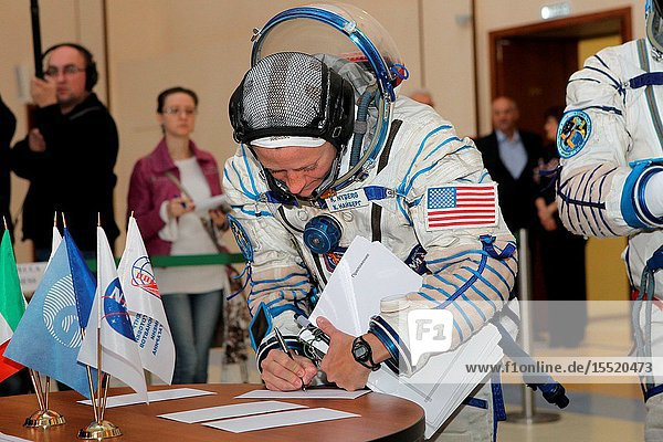 At the Gagarin Cosmonaut Training Center in Star City  Russia  Expedition 3637 Flight Engineer Karen Nyberg of NASA signs in for the start of final qualification training April 30 as she and her crewmates prepare for their launch May 29  Kazakh time  in their Soyuz TMA-09M spacecraft from the Baikonur Cosmodrome in Kazakhstan. Nyberg is launching with Soyuz Commander Fyodor Yurchikhin  Russian cosmonaut  and Luca Parmitano of the European Space Agency for a 5 ½ month mission on the International Space Station.