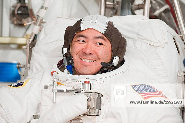 Japan Aerospace Exploration Agency (JAXA) astronaut Akihiko Hoshide  Expedition 3233 flight engineer  participates in an Extravehicular Mobility Unit (EMU) spacesuit fit check in the Space Station Airlock Test Article (SSATA) in the Crew Systems Laboratory at NASA's Johnson Space Center.