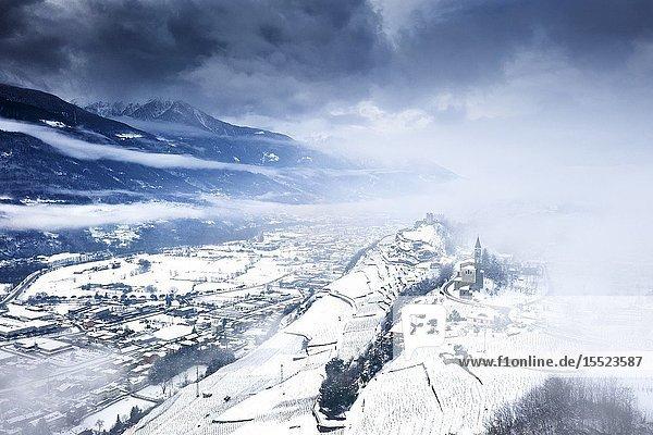 Aerial view of Castel Grumello and vineyards with snow. Montagna in Valtellina  Valtellina  Sondrio province  Italy  Europe.