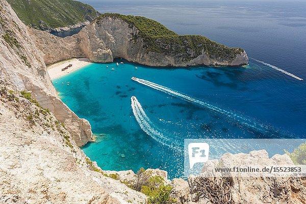 Boat wakes in the Ionian sea at Shipwreck beach  Zakynthos  Ionian Islands  Greece  Europe.