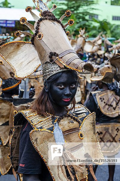 Young People Dressed In Tribal Costume Parade Through The Streets Of Kalibo During The Annual Ati-Atihan Festival  Kalibo  Panay Island  Aklan Province  Western Visayas  The Philippines.