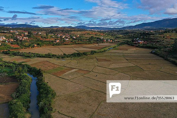 Rice fields and small mud villages near Sandrandahy  on the National Route RN7 between Ranomafana and Antsirabe  Madagascar.