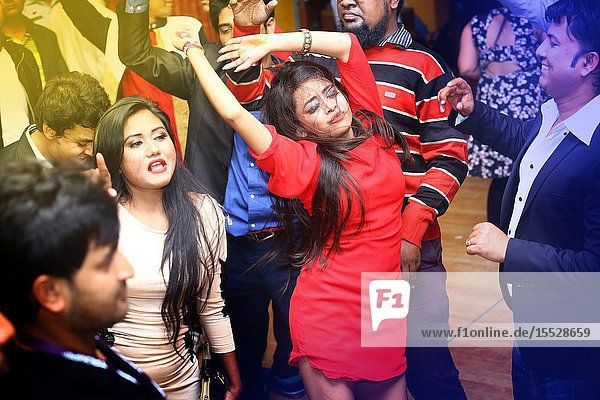 Bangladesh - January 01  2016: Young Peoples are dancing and enjoying DJ Party at Picasso Restaurant in Capital city of Dhaka.