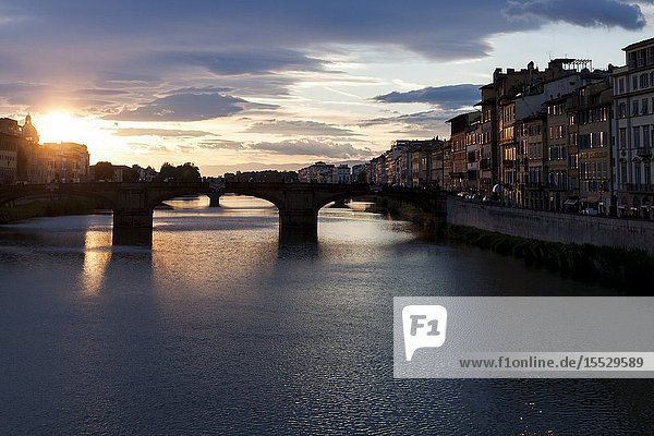The evocative spring sunset over the Arno. Florence  Tuscany. Italy.