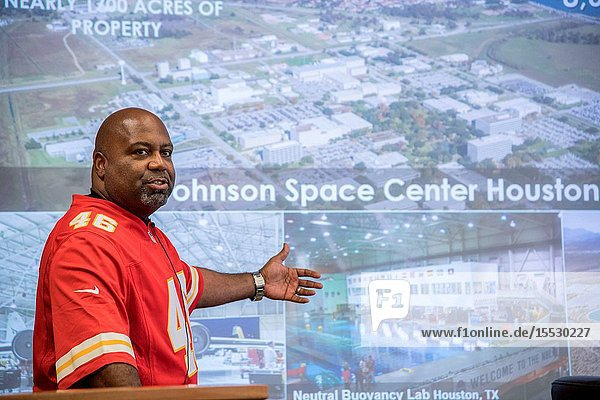 Former NFL player Daryl Gaines (K.C>  Chiefs) briefs a large group of former NFL players on the Johnson Space Center's (JSC) many missions during the JSC Super Bowl Tailgate event. Daryl is currently assistant to the Center Director of JSC and is a member of the JSC Super Bowl Committee collaborating between JSC and the Houston NFL Super Bowl Committee to plan joint activities for JSC participation in Super Bowl LI. Center Director Ellen Ochoa invited the former NFL players to JSC as part of our Super Bowl Live events. During the week before the Super Bowl the former players visited Mission Control  and other JSC areas taking time to stop and give autographs and photo opportunities to JSC Staff members. NASA POTOGRAPHER Lauren Harnett.