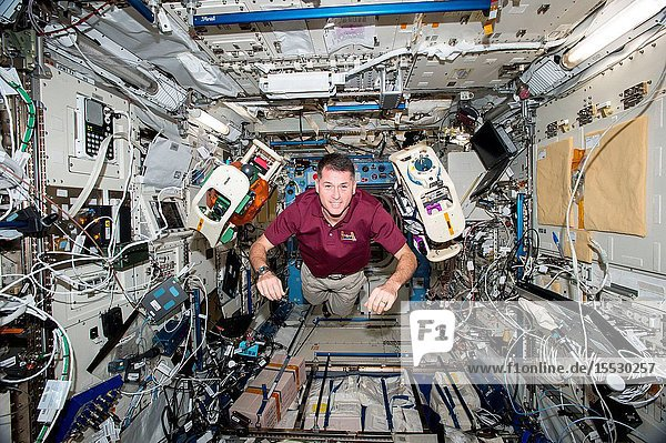 NASA astronaut Shane Kimbrough is seen executing the SPHERES-Halo experiment aboard the International Space Station. The investigation uses two small  self-contained satellites (SPHERES) fitted with donut like rings to test wireless power transfer and formation flight using electromagnetic fields.