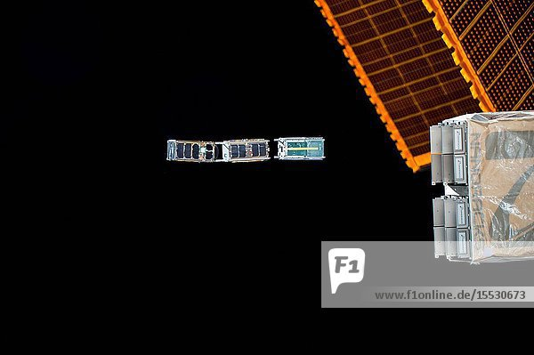 Three CubeSats are ejected from the NanoRacks CubeSat Deployer attached to the outside of the Japanese Kibo laboratory module. The trio are part of a subset CubeSats released during the week to monitor different gaseous molecules and electrical properties of the Earth's thermosphere to better understand space weather and its long term trends.