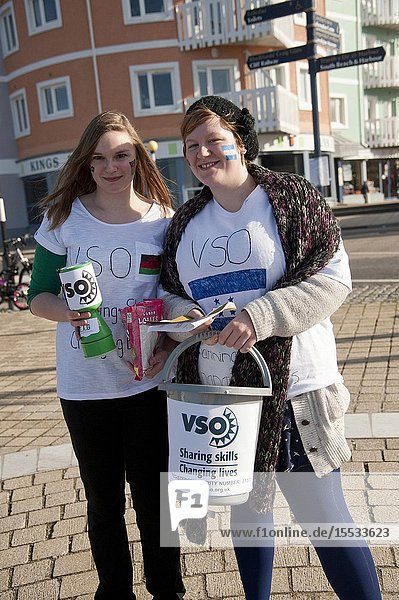 Two young women collecting charity donations for Voluntary Service Overseas VSO.