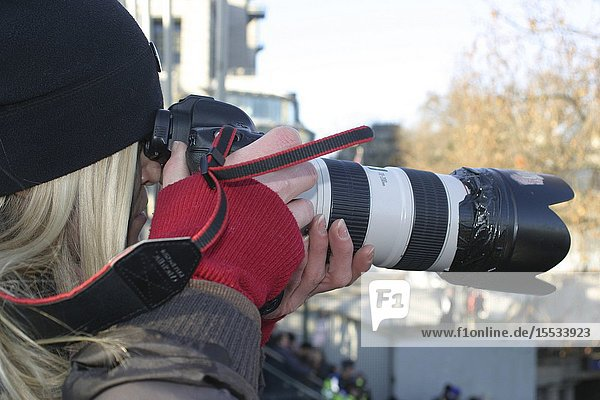 Photographer at pro Palestinian march and rally protesting against Israeli military action in Gaza  London 3 Jan 2009
