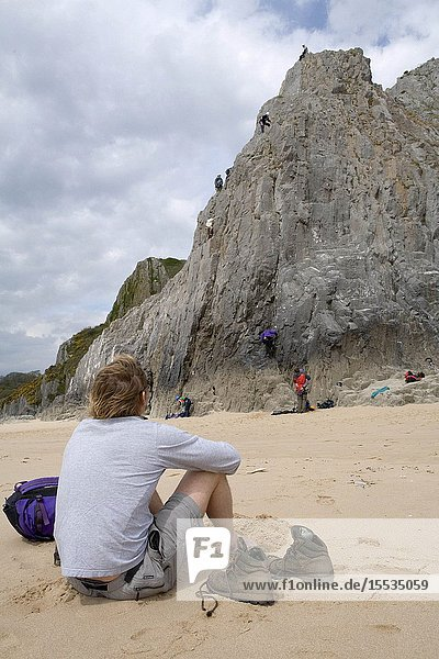 Man watching group of rock climbers