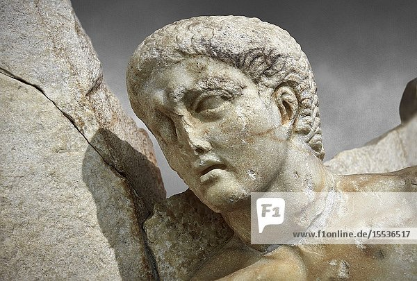 Close up of a Roman Sebasteion relief sculpture of Orestes At Delphi Aphrodisias Museum  Aphrodisias  Turkey.Orestes who has sought sanctuary at Delphi after murdering his mother  leaves Apollo's shrine on his way to stand trial in Athens  The hero steps gingerly over sleeping Fury  he brandishes a sword and still hold onto Apollo's tripod. The Fury has a snake and a burning torch with which she torments male factors. A small local nymph sits above on a rocky outcrop of Delphi's Mt Parnossos.