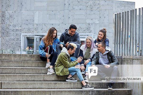 Young people sitting on stairs  Zuloaga Square  Donostia  San Sebastian  Gipuzkoa  Basque Country  Spain