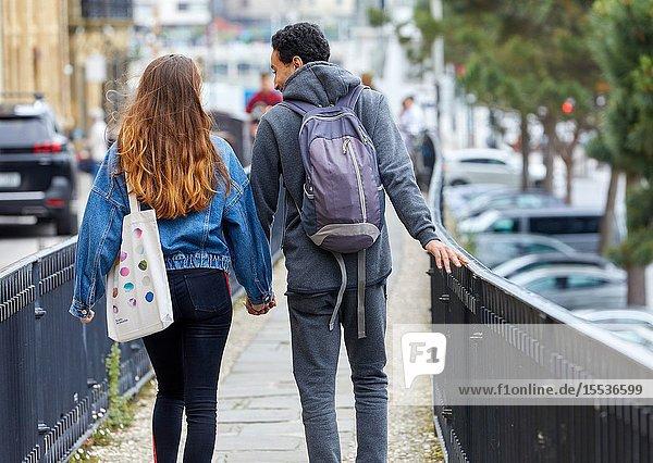 Couple of tourists visiting the city  Multiracial young couple  Donostia  San Sebastian  Gipuzkoa  Basque Country  Spain