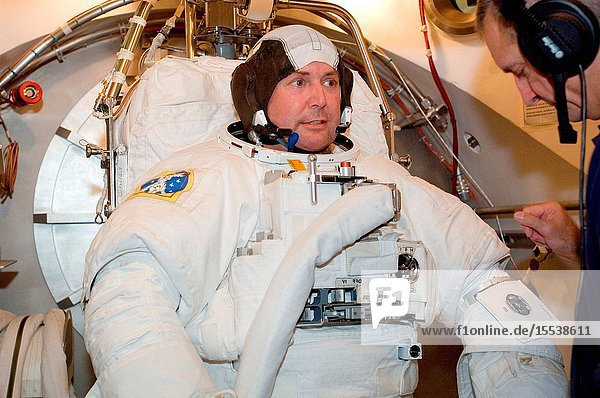 Astronaut Michael J. Foreman  STS-123 mission specialist  participates in an Extravehicular Mobility Unit (EMU) spacesuit fit check in the Space Station Airlock Test Article (SSATA) in the Crew Systems Laboratory at the Johnson Space Center.