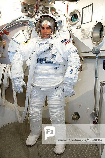 Astronaut Christopher Cassidy  STS-127 mission specialist  participates in an Extravehicular Mobility Unit (EMU) spacesuit fit check in the Space Station Airlock Test Article (SSATA) in the Crew Systems Laboratory at NASA's Johnson Space Center.