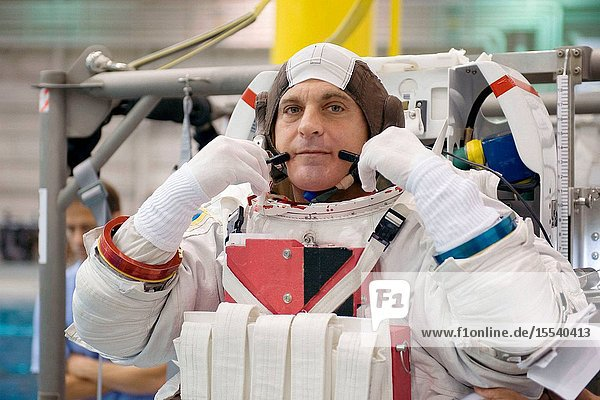 Attired in a training version of his Extravehicular Mobility Unit (EMU) spacesuit  astronaut Dave Wolf  STS-127 mission specialist  awaits the start of a training session in the waters of the Neutral Buoyancy Laboratory (NBL) near NASA's Johnson Space Center.