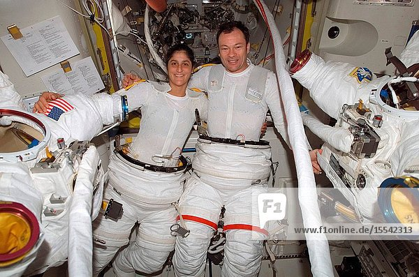 Astronauts Sunita L. Williams  flight engineer  and Michael A. Lopez-Alegria  commander and NASA ISS science officer  don their extravehicular mobility unit (EMU) space suits onboard the International Space Station prior to one of several Expedition 14 spacewalks. This marks the third extravehicular activity in nine days.