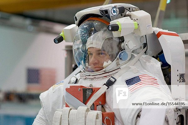 Astronaut Jeffrey Williams  Expedition 21 flight engineer and Expedition 22 commander  attired in a training version of his Extravehicular Mobility Unit (EMU) spacesuit  awaits the start of a training session in the waters of the Neutral Buoyancy Laboratory (NBL) near Johnson Space Center.