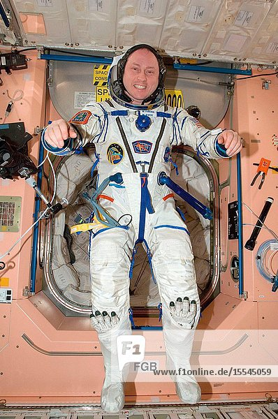 NASA astronaut Michael Fincke  Expedition 18 commander  attired in his Russian Sokol flight suit  poses for a photo in the Unity node of the International Space Station.