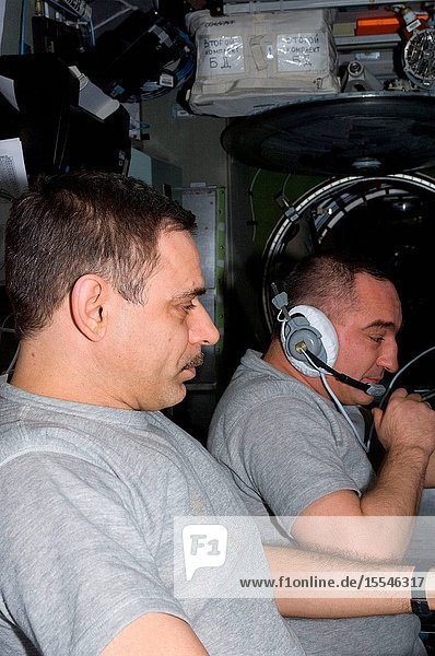 Russian cosmonauts Alexander Skvortsov (background) and Mikhail Kornienko  Expedition 24 commander and flight engineer  respectively  monitor data at the manual TORU docking system controls in the Zvezda Service Module of the International Space Station during the approach of the ISS Progress 38 supply vehicle. The attempted docking on July 2  2010  was aborted when telemetry between the Progress and the space station was lost about 25 minutes before its planned docking. As a result  the Progress vehicle continued on its trajectory and glided past the space station. Later  the Progress successfully docked to Zvezda's aft end at 12:17 p.m. (EDT) on July 4  2010. The docking was executed flawlessly by Progress' Kurs automated rendezvous system.