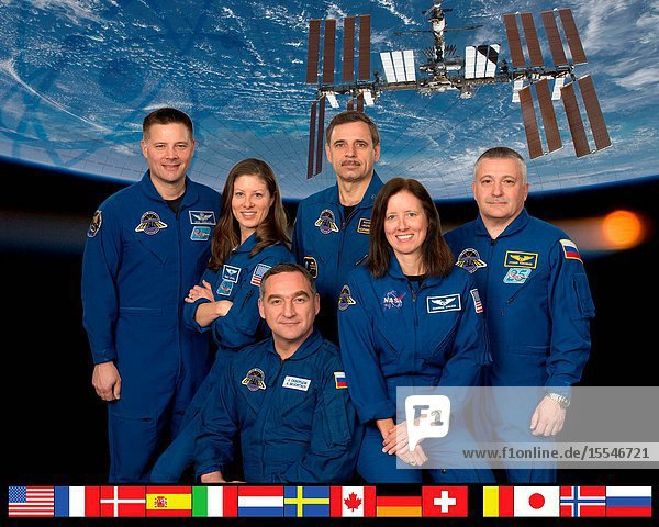 Expedition 24 crew members take a break from training at NASA's Johnson Space Center to pose for a crew portrait. Pictured clockwise are Russian cosmonaut Alexander Skvortsov (bottom)  commander  NASA astronauts Tracy Caldwell Dyson and Doug Wheelock  Russian cosmonauts Mikhail Kornienko and Fyodor Yurchikhin  along with NASA astronaut Shannon Walker  all flight engineers.