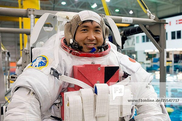 Japan Aerospace Exploration Agency (JAXA) astronaut Koichi Wakata  Expedition 38 flight engineer and Expedition 39 commander  awaits the start of a spacewalk training session in the waters of the Neutral Buoyancy Laboratory (NBL) near NASA's Johnson Space Center. Wakata is wearing a training version of his Extravehicular Mobility Unit (EMU) spacesuit.