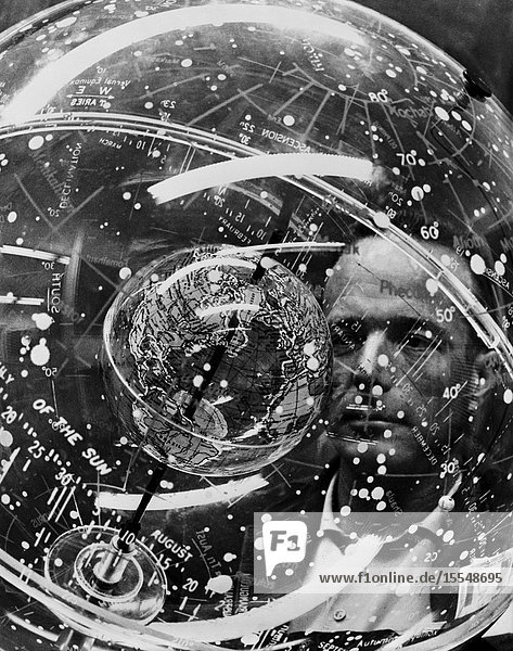Astronaut M. Scott Carpenter looks into a Celestial Training Device (globe) during training in the Aeromedical Laboratory at Cape Canaveral  Florida.