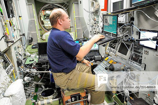 Russian cosmonaut Oleg Kotov  Expedition 38 commander  practices manual docking techniques with the TORU  or telerobotically operated rendezvous system  in the Zvezda Service Module of the International Space Station in preparation for the docking of the Progress 53 spacecraft. Kotov  using the Simvol-TS screen and hand controllers  could manually dock the Progress to the station in the event of a failure of the Kurs automated docking system. The Progress 53 craft is scheduled to complete its automated docking to the aft port of Zvezda at 5:28 p.m. (EST) on Nov. 29.