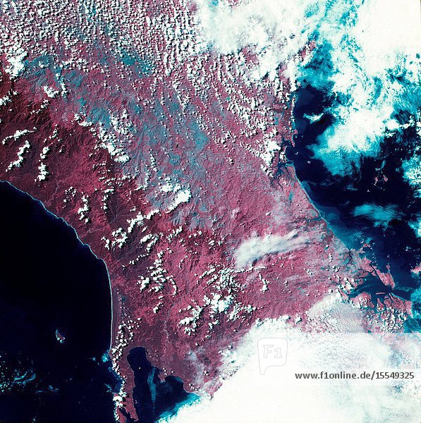 A vertical view of the western portion of the Republic of Panama on the Isthmus of Panama as photographed from Earth orbit by one of the six lenses of the Itek-furnished S190-A Multispectral Photographic Facility Experiment aboard the Skylab space station. This picture was taken with 2443 infrared color film. The large  clear body of water on the north side of the isthmus is Golfo de los Mosquitos  an extension of the Caribbean Sea. The large  partly cloud-covered body of water on the south side of the isthmus is Golfo de Chiriqui  an extension of the Pacific Ocean. Federal agencies participating with NASA on the EREP project are the Department of Agriculture  Commerce  Interior  the Environmental Protection Agency and the Corps of Engineers. All EREP photography is available to the public through the Department of Interior's Earth Resources Observation Systems Data Center  Sioux Falls  South Dakota  57198.