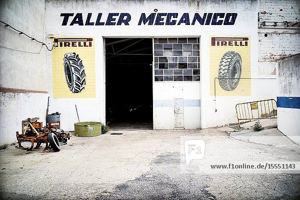 Facade of a Mechanical Workshop. Falset  Tarragona  Catalonia  Spain  Europe.