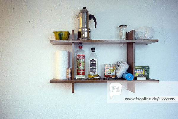 Shelf with kitchen utensils  coffee maker  oil  jars etc. Mahon  Baleares  Spain  Europe.