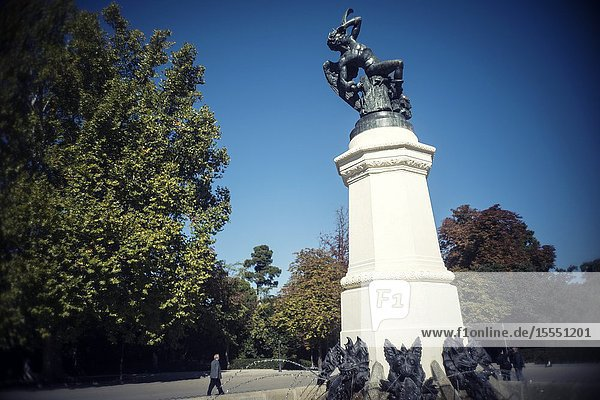 Fountain of the fallen Angel with a man walking. Retiro Park  Madrid  Spain  Europe.