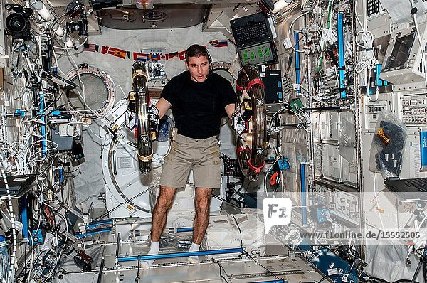 In the International Space Station's Kibo laboratory  NASA astronaut Michael Hopkins  Expedition 37 flight engineer  conducts a session with a pair of bowling-ball-sized free-flying satellites known as Synchronized Position Hold  Engage  Reorient  Experimental Satellites  or SPHERES. Surrounding the two SPHERES mini-satellites is ring-shaped hardware known as the Resonant Inductive Near-field Generation System  or RINGS. SPHERES-RINGS seeks to demonstrate wireless power transfer between satellites at a distance for enhanced operations.