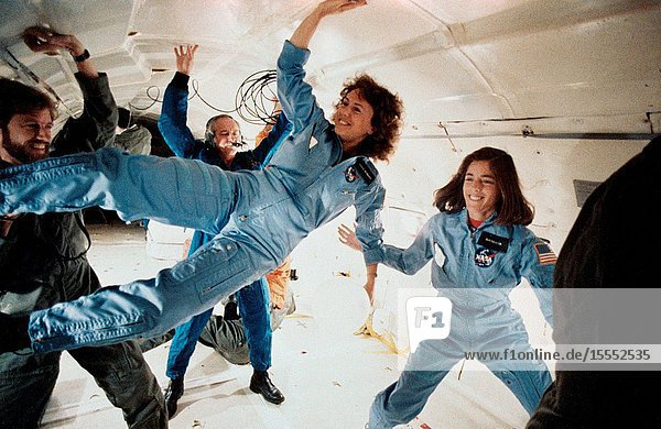 The two representatives of the Teacher-in-Space Project continue their training program at the Johnson Space Center with an additional flight aboard NASA's KC-135 zero gravity aircraft. Sharon Christa McAuliffe  left  is prime crew payload specialist  and Barbara R. Morgan is in training as backup payload specialist. The photo was taken by Keith Meyers of New York Times.