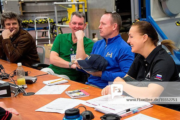 NASA astronaut Barry Wilmore (second right)  Expedition 41 flight engineer and Expedition 42 commander  along with Russian cosmonauts Elena Serova and Alexander Samokutyaev  both Expedition 4142 flight engineers  are pictured during an emergency scenario training session in the Space Vehicle Mock-up Facility at NASA's Johnson Space Center. Interpreter Mark Pace (far left) assisted the crew members.