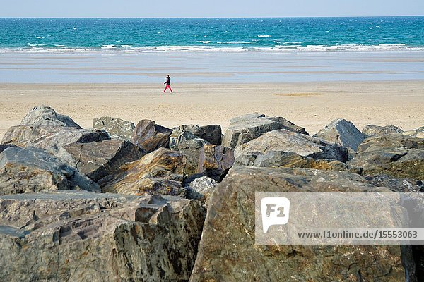 France  Bretagne  Cotes d'Armor  Plerin  the and rocks  woman going for a walk