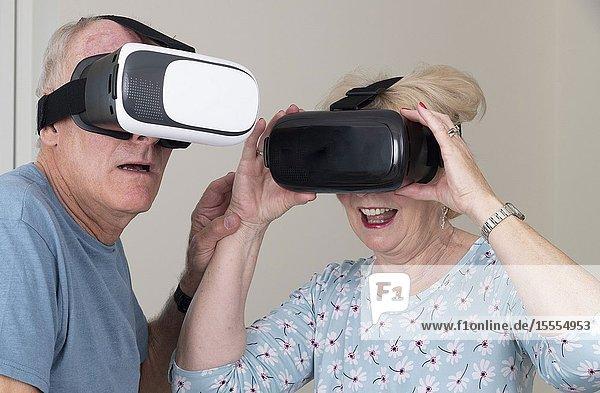 Portsmouth UK  May 2019. Elderly couple having fun wearing virtual reality goggles