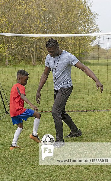 Young soccer player being coached on a football pitch. Hampshire  England UK. April 2019.