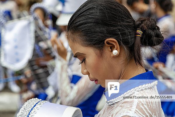 A Filipino Secondary Schoolgirl Gets Ready To Take Part In The Tambor Trumpa Martsa Musika (Drum & Bugle Corps) Contest  Dinagyang Festival  Iloilo  Panay Island  The Philippines.