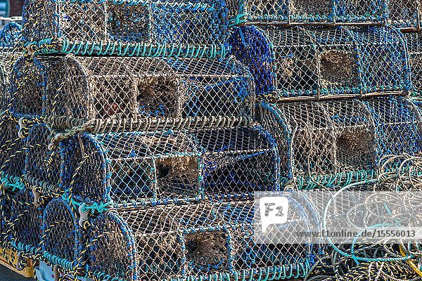 Crab and lobster pots or creels stacked on Wells-next-the-sea seafront. North Norfolk coast,  East Anglia,  England,  UK.