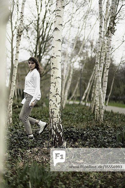 Young woman in the forest. Berlin  Germany.