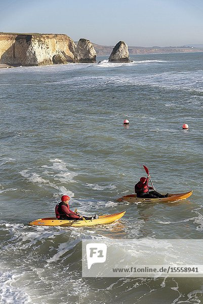 Freshwater Bay  Isle of Wight  England  UK. February 2019. Couple learning to kayak in a slight swell on Freshwater Bay in the west of the Isle of Wight a popular holiday resort.